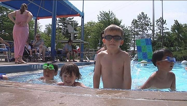 Kids playing in the water during the heat wave