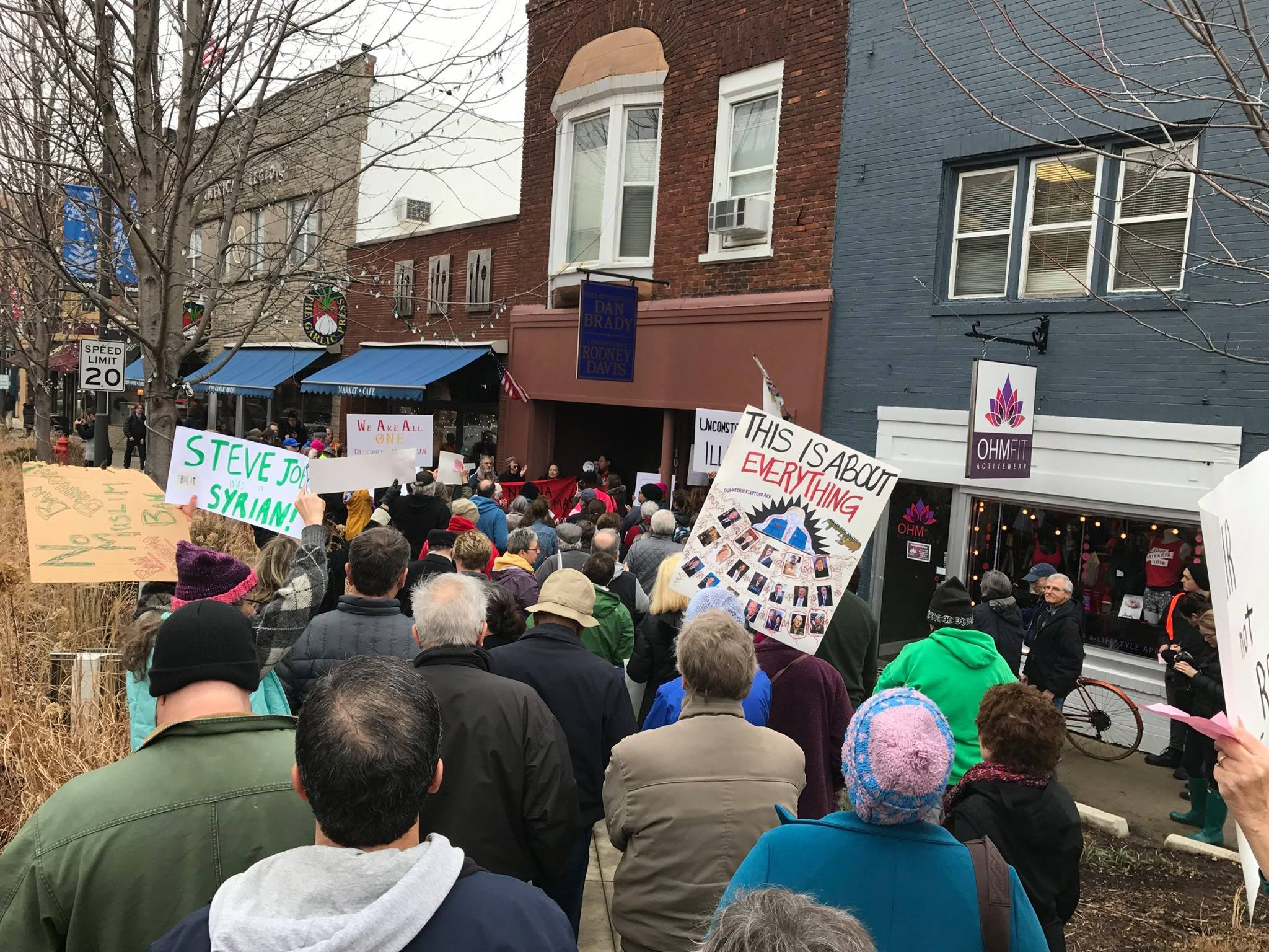 Illinois Peoples Action rallies outside Rep. Rodney Davis' office in the Twin Cities in this February file photo.
