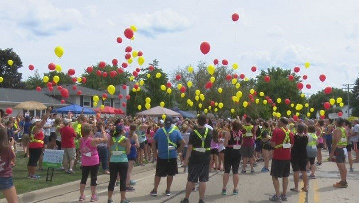 Runners started the run with balloons, and carried them until they arrived at Nathan's lemonade stand before releasing them as tribute.