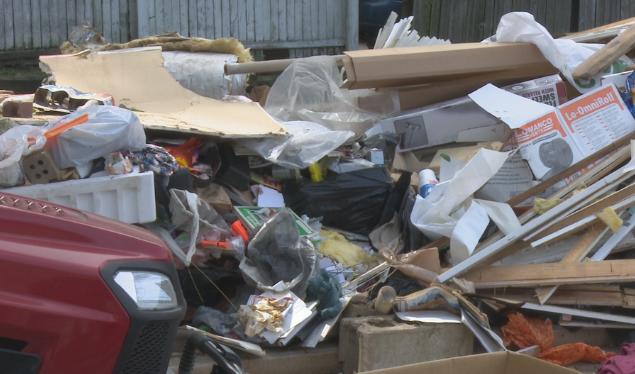 Trash dumped in Ed Tarpley's driveway by Dragon Dumps