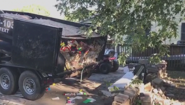 garbage being dumped in Ed Tarpley's driveway by owner of 'Dragon Dumps'