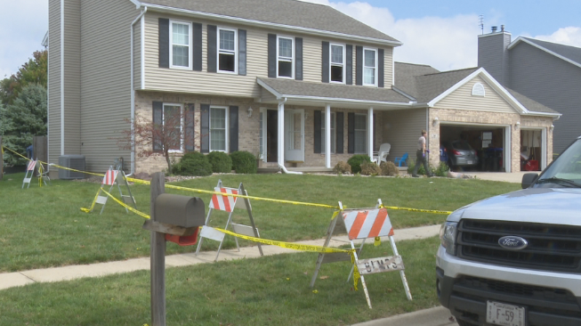 police tape surrounds the home in Bloomington after deadly fire