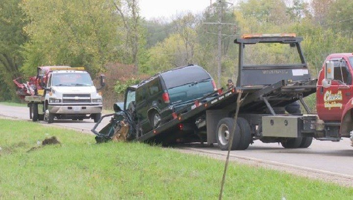 One man (driving the red car, on the back of the truck on the left) was killed in Friday's head-on collision. There is 'great concern,' for the unborn baby of the woman driving the green SUV.