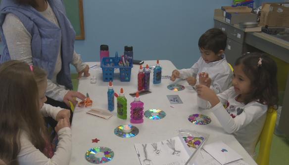 Children at the Peoria Children's Playhouse make Diwali crafts