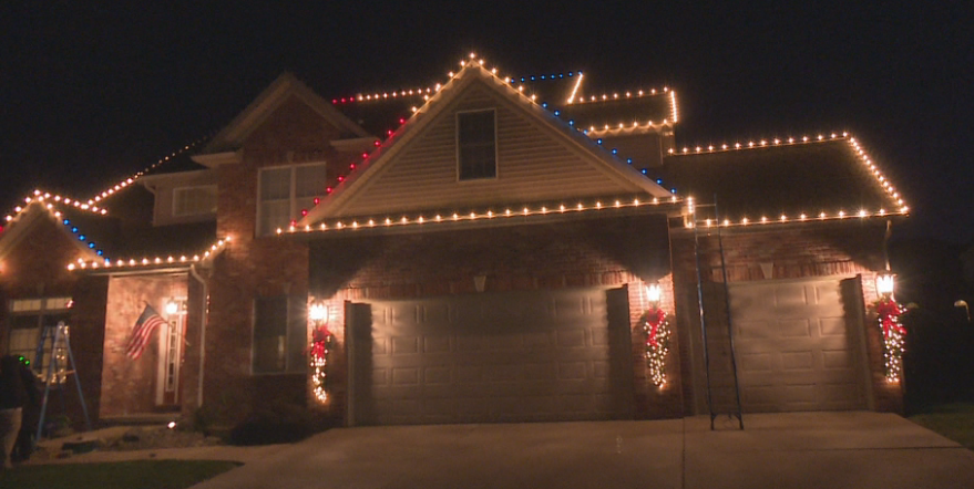 Surprise red, white and blue holiday lights on the Heuer home