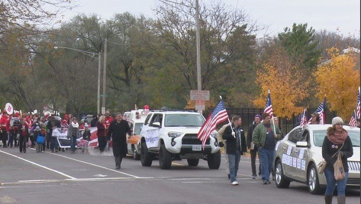 Dozens of cars and floats wound their way through the River City Saturday, all with the same message: A big 'Thank You' to Veterans