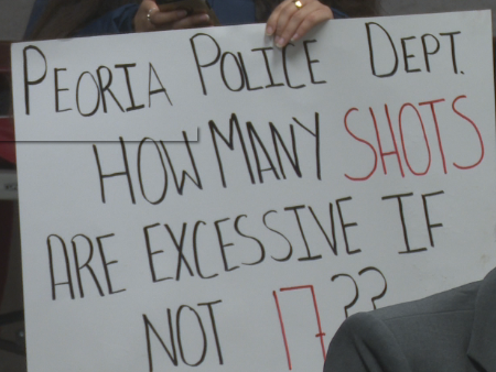 Signs from the peaceful protest outside Peoria Police HQ