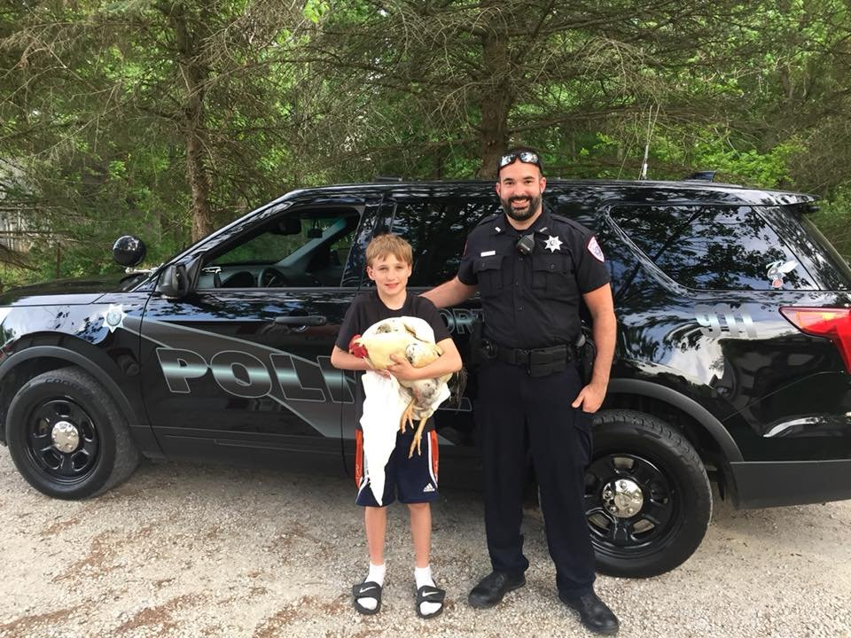 Officer Payne and Jackson Geriets, with rooster