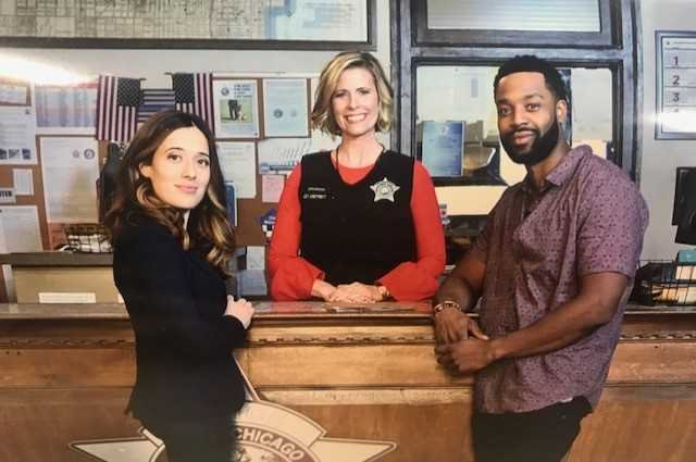 Caitlin Knute poses w/ stars of Chicago PD