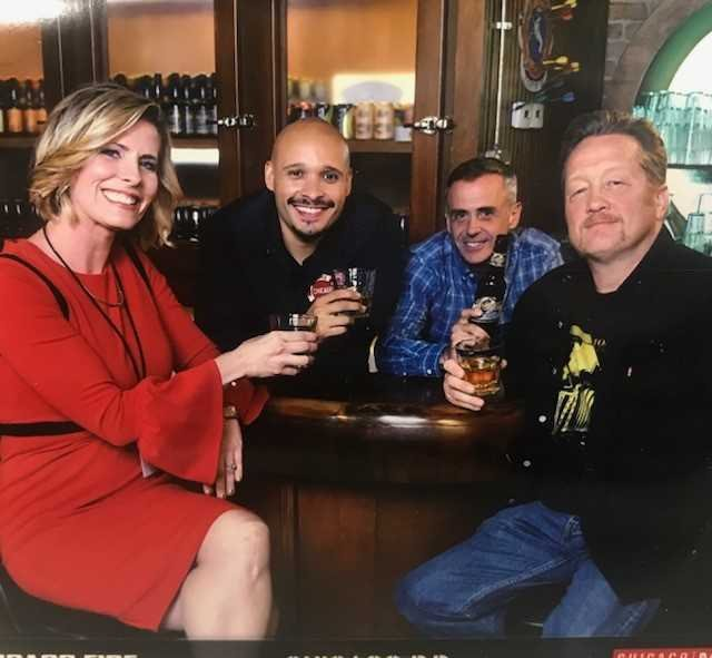 Chicago Fire stars pose for pic on set w/ Caitlin Knute (drinks not real!)